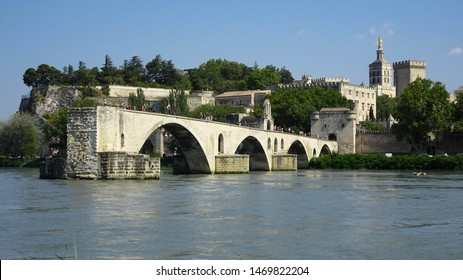 The bridge of Avignon (Pont d'Avignon in French) is famous medieval bridge streching over part of Rhone river in city of Avignon, Provence, France, Europe, view with Pope's Palace behind bridge