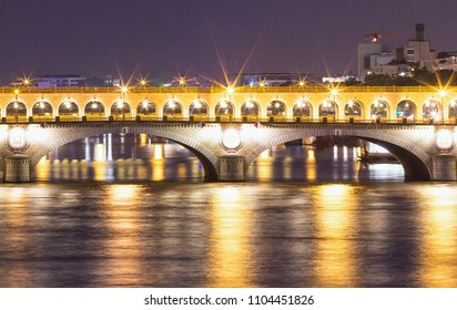 The bridge Bercy at night, Paris, France. It is a vital artery between the two banks, and although the bridge has been enlarged, the original was constructed back in the 1800s.