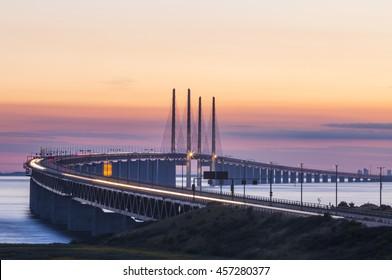 The bridge between Copenhagen Denmark and Malmo Sweden, Oresundsbro, when sunset in the summer evening