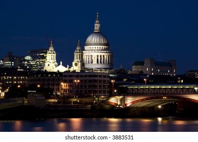 Bridge Blackfriars at night with St.Paul Cathedral in London