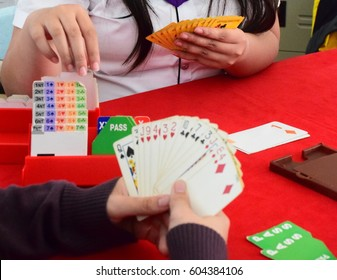 Bridge card game with hand pick card from bidding box