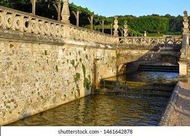 Bridge and chanel cascade in a formal garden.