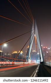 Bridge and city urban architecture at night in Chongqing, China.