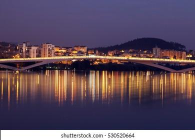 Bridge in Coimbra seen at sunset. Coimbra, Centro Region, Portugal.