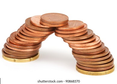 Bridge of coins in front of a white background