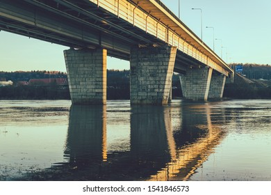 Bridge crossings the river - Water reflections in the evening