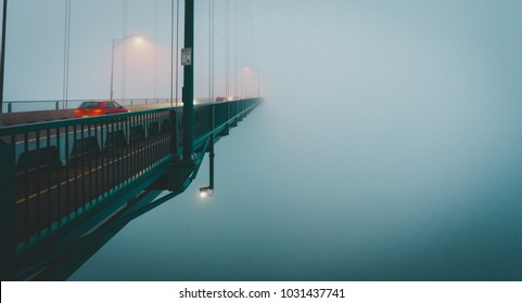 A bridge disappearing into the fog