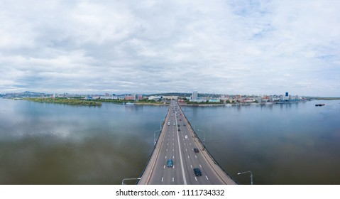 Bridge, in the downtown, through the river, shooting from air