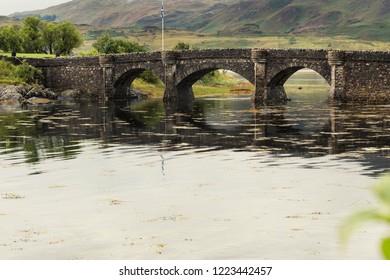 Bridge of Eilan Donan Castle fortified castle built in the mid 13th century. Scotland England