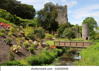 Bridge and flowers with Blarney castle in background. Ireland