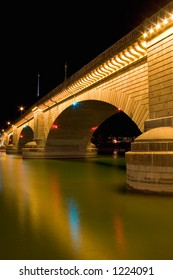 A bridge (from London) was brought over and built in Lake Havasu City, Arizona. Photographed at night underneath the bridge.