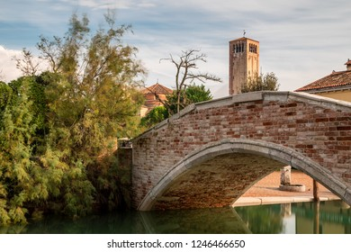 Bridge in front of the church of Santa Maria Assunta on the island of Torcello, Venice, Italy