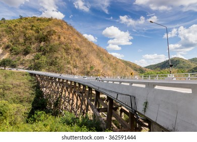 bridge front of mountain with  blue sky view