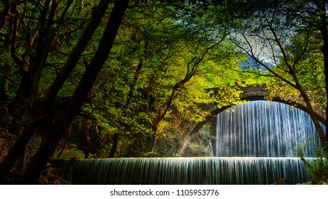 bridge in front of a shady waterfall