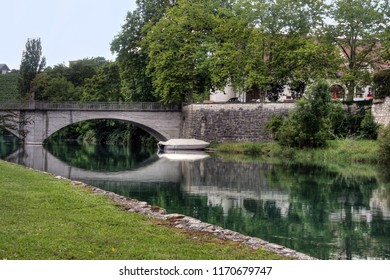 Bridge with garden over the rhine river in Swiss town Rheinau connecting the monastery on the island, Switzerland