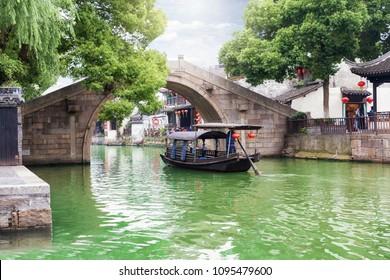 Bridge and gondola in the watertown Tongli, the Venice of Asia, near Suzhou, Shanghai, China