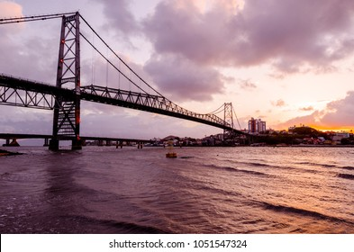 bridge Hercilio Luz Florianopolis Santa Catarina Brazil, image made from the island, showing the sunset. This bridge is from the beginning of the 20th century, does not have vehicular trafic