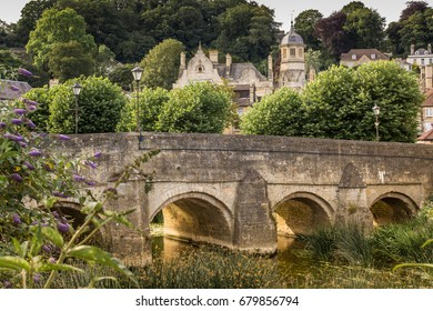The Bridge An image of Bradford on Avon's historic 18th century bridge over the river Avon, with the late afternoon sun reflecting off the bridge supports