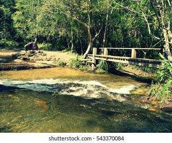 Bridge in the jungle waterfall