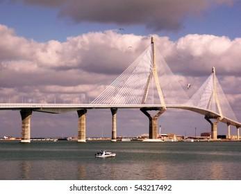 Bridge of La Constitucion, called La Pepa, with boat, sea and clouds in Cadiz, Andalucia. Spain