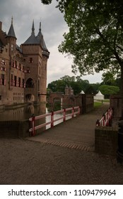 Bridge leading to the beautiful De Haar Castle reflected in the surrounding moat on the castle grounds