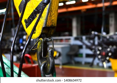 Bridge lifting Crane Hook against the background of the Assembly Line industrial factory. The concept of a heavy automotive manufacturing process at an industrial plant, background texture - Image