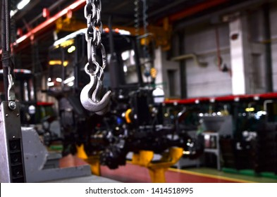 Bridge lifting Crane Hook against the background of the Assembly Line industrial factory. The concept of a heavy automotive manufacturing process at an industrial plant, background, texture - Image