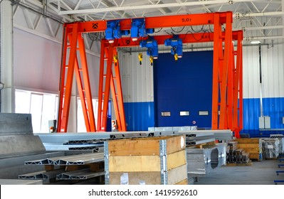 Bridge lifting Crane with Hooks on the background of the industrial workshop production plant. The concept of a heavy manufacturing process at an industrial factory, background, texture - Image
