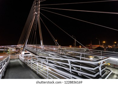 bridge with lighting over the road in the city at night