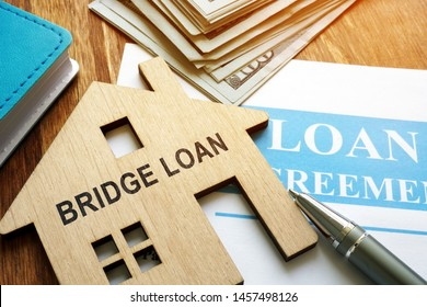 Bridge loan and mortgage agreement with pen.