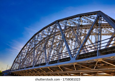 Bridge from low angle view with clear blue sky in the background