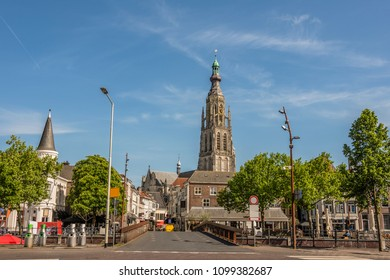 Bridge and main street entrance to the city of Breda. Stresses the tower of the great church of Breda. Netherlands
