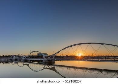 Bridge next to the Tempe Center for the Arts in Phoenix Arizona with sunrise.