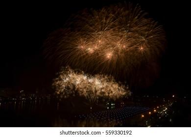 Bridge in Nhong Prajak Public Park Bridge with fireworks. Udonthani, Thailand.