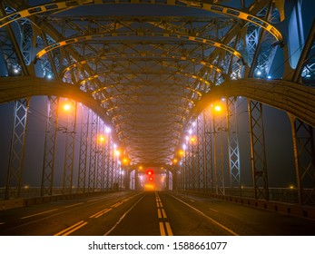 Bridge at night. Construction of bridges. Concept - road architecture. Road markings. Lanterns illuminate the bridge at night. Evening city. Bolsheokhtinsky. Saint Petersburg. Russia.