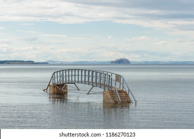 The Bridge To Nowhere, was built during Victorian beach improvement scheme. It crosses Biel Water where it flows in Belhaven Bay and the North Sea at Dunbar in Scotland.