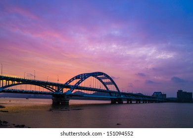 bridge on the Qiantang river with sunset