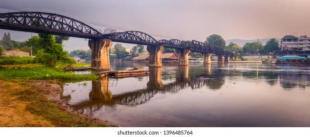 The bridge on the river Kwai at sunrise. Beautiful view of Railway. Touristic attraction in Kanchanaburi, Thailand. Panorama