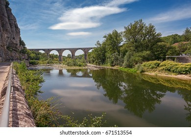 The bridge over the Ardeche river near the village of Vogue in the Ardeche region in France.