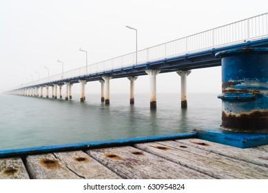 The bridge over Black Sea, seafront and seaside with blue water and gold sand, Mamaia, Romania. Pontoon Bridge Mamaia.(Pasarela) Dock on the Beach