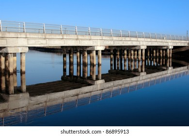 bridge over a calm cold river in kerry ireland reflected on a frosty morning