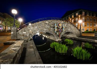 Bridge over Carroll Creek at night, at Carroll Creek Linear Park, in Frederick, Maryland.