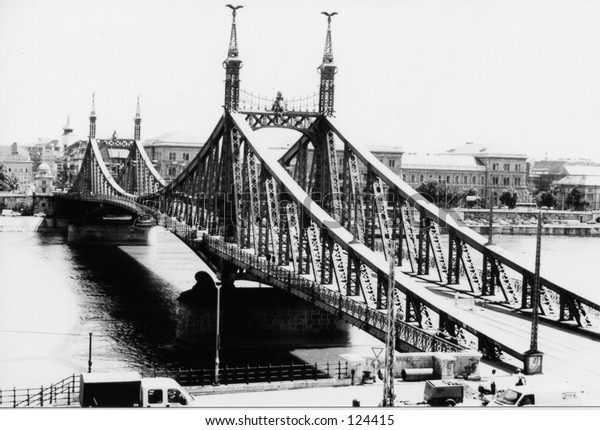 Bridge over the Danube River in Budapest, Hungary. Black and white photo taken at mid day.