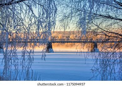 Bridge over frozen river in Norway