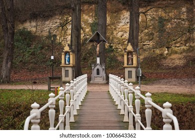 Bridge over the Geul river leads to the crucifix under a wooden roof and two small chapels