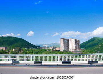 Bridge over the gorge of the Arpa River. View of Gladzor Sanatorium, mountains and blue sky. The city of Jermuk, Armenia.