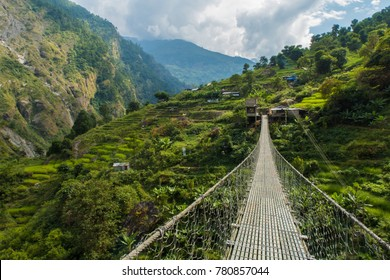 Bridge over a green valley in Nepal