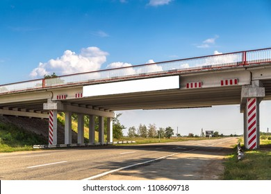 the bridge over the highway with a banner