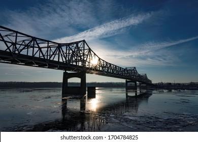 Bridge over Icy Waters at Sunrise