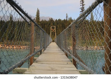Bridge over Kootenay river at Kootenay National Park in Canada during summer sunset.